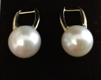 11-12mm pearl earrings with 18kt gold setting