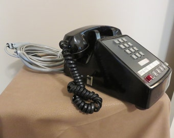 Bell System push button telephone with cable wiring attached