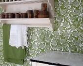 Handmade luxury designer wallpaper, lino printed 'Ramson' design.