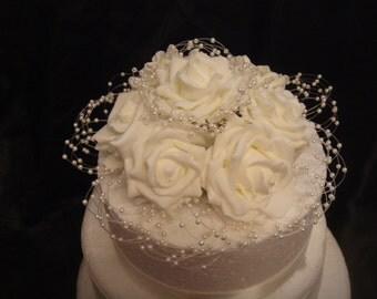 an ivory pearl hoop rose wedding cake topper