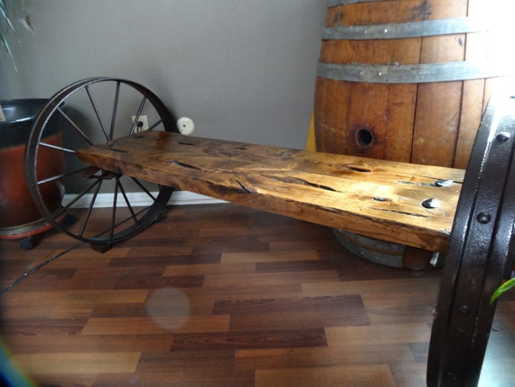 Handcrafted antique wagon wheel bench