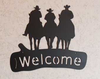 Three Cowboys on Horseback Welcome sign