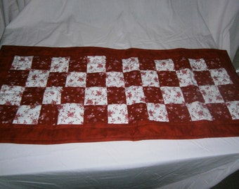 Quilted table runner, red and white.