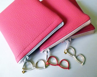 A mini pink pouch with pale pink faux zipper