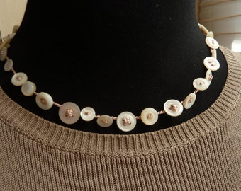Pale Pink colored necklace with vintage shell buttons