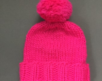 Hand knitted 100% merino wool bobble ladies bobble hat. Bright pink, extra large Pom Pom