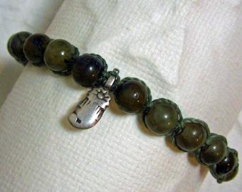 Adjustable macrame bracelet with labradorite beads and antique sterling mango charm