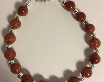 "Brown Goldstone Beaded Bracelet (Natural Stone) with silver findings Measures 8""."