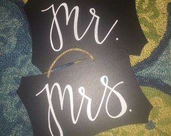 Mr And Mrs Chair signs for wedding