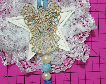 Angel with blue ribbon and lace