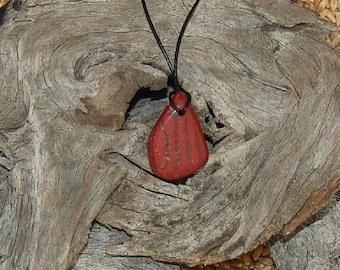 Polished stone pendant