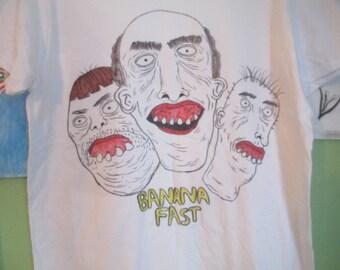 The three dudes T shirt