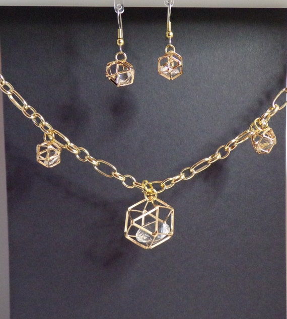 Goldtone and faceted crystal necklace and earring set