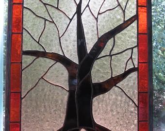 "14""x19"" Tree of Life stained glass suncatcher, bright orange/red border, light amber/gold starburst background, brown trunk, original design"