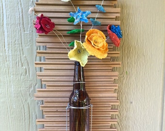 Whimsical hanging floral arrangement made of recycled items, hanging floral, recycled art