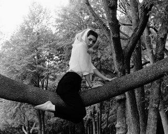 Woman on a tree, self-portrait