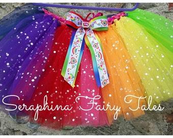 Unicorn Rainbow Tutu. Bright & Colourful Rainbow Tutu skirt with Unicorn Bow. Handmade by Seraphina Fairy Tales