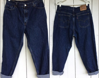 Levis 550 jeans, size 33 waist, high waisted jeans, mom jeans, dark blue, made in USA jeans, boyfriend jeans, relaxed fit tapered, 90s jeans