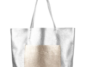 Real silver with gold leather hobo bag.