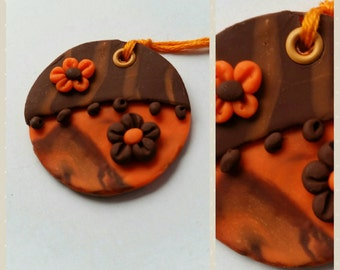 Rust orange and brown daisy polymer clay pendant, 3mm hole.