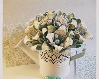 Origami bouquet in a white watering can
