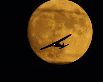 plane in the moon