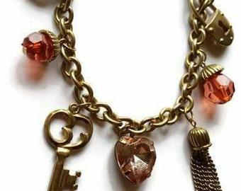 Handmade bronze charm bracelet.