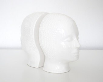 vintage 1980s white glazed ceramic book ends in the form of two faces, postmodern design, eighties ceramics, home decoration