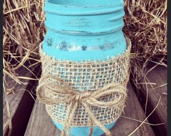 Rustic mason jar with burlap