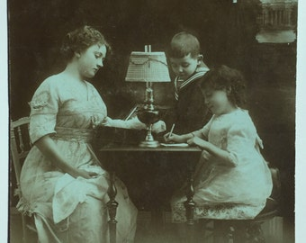 Children writing to their Father * Sad mother overlooking * Antique Black and White photograph on postcard RPPC * The dream