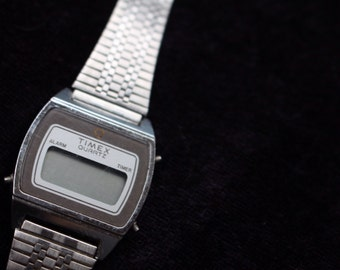 Vintage timex watch, silver coloured metal band