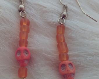 Orange, beaded skull drop earrings