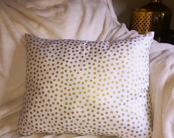 Gold polka dot pillow