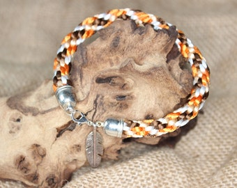 Kumihimo bracelet with feather charm