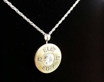 Stunning cartridge pendant with sterling silver findings and chain. Available with different coloured swarovski crystals in the centre.