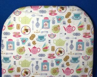"Handmade tea cozy in ""tea party"" fabric"