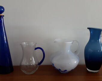 An assortment of glass pitchers and bottles