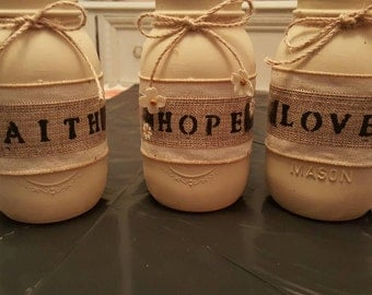 Hand crafted Mason jars hand monogrammed painted includes all three jars as a set.