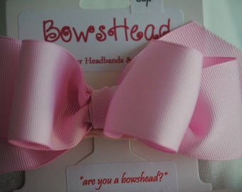 Grosgrain ribbon bow on clip.