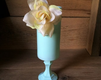 Candle holder with flower