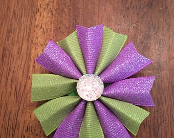 Purple and green gemstone bow