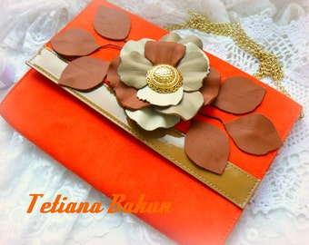 orange clutch with lether flower