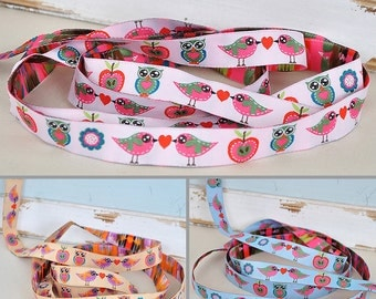 Web belts 16 mm wide with colorful bird motifs