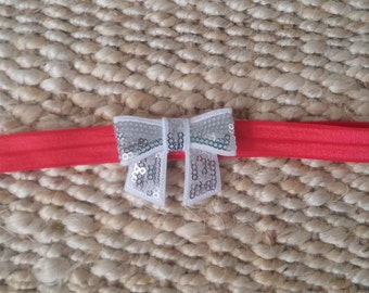 Red hairband with white sparkle bow