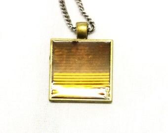 A Square Honey Colored Pendant