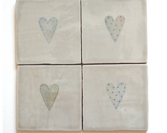 Handmade ceramic coasters with hearts on a taupe background. Heart coasters in gift box. Gift for her. Wedding present. Drinks coasters