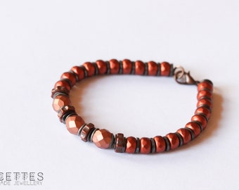 Bracelet with glass beads and spacers, with several tones of copper color