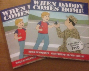 "Signed copy of ""When Daddy Comes Home."""