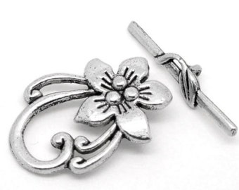 Clasp ring and stick / toggle flower x 2