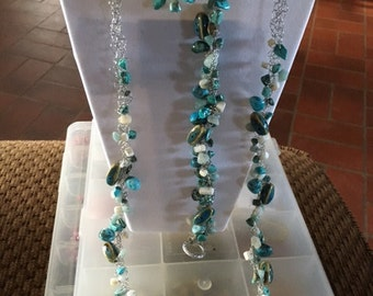 49 turquoise and white beads on silver wire